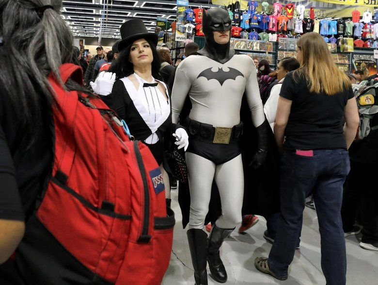 Conventiongoers cruise the vendor booths at 2019's Emerald City Comic Con at the Washington State Convention Center. ECCC postponed this year's event because of coronavirus concerns. (Alan Berner / The Seattle Times, file)