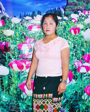"""""""Tojsiab Woman"""" by Pao Houa Her, 2015. Found image with opium floral backdrop from a website that connects Hmong American men with Hmong Laotian women. According to the artist, images like these are symbolic of feminine beauty, economic stability, and a vision of Laos before the American war. (Courtesy of Arts at King Street Station)"""