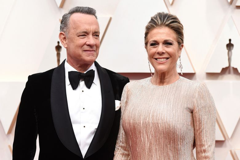 FILE – In this Sunday, Feb. 9, 2020 file photo, Tom Hanks, left, and Rita Wilson arrive at the Oscars at the Dolby Theatre in Los Angeles. Hanks and Wilson were diagnosed with coronavirus last spring but have since recovered. (Photo by Jordan Strauss/Invision/AP)