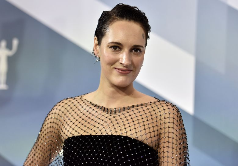 """FILE – In this Sunday, Jan. 19, 2020 file photo, Phoebe Waller-Bridge arrives at the 26th annual Screen Actors Guild Awards at the Shrine Auditorium & Expo Hall on , in Los Angeles. The one-woman stage version of Waller-Bridge's barbed sitcom """"Fleabag"""" is nominated for best entertainment or comedy play at Britain's Olivier theater awards, it was announced Tuesday, March 3, 2020. Waller-Bridge is also nominated for best actress in a play, competing with Hayley Atwell for """"Rosmersholm,"""" Sharon D. Clarke for """"Death of a Salesman,"""" and Juliet Stevenson for """"The Doctor.""""     (Photo by Richard Shotwell/Invision/AP, file)"""