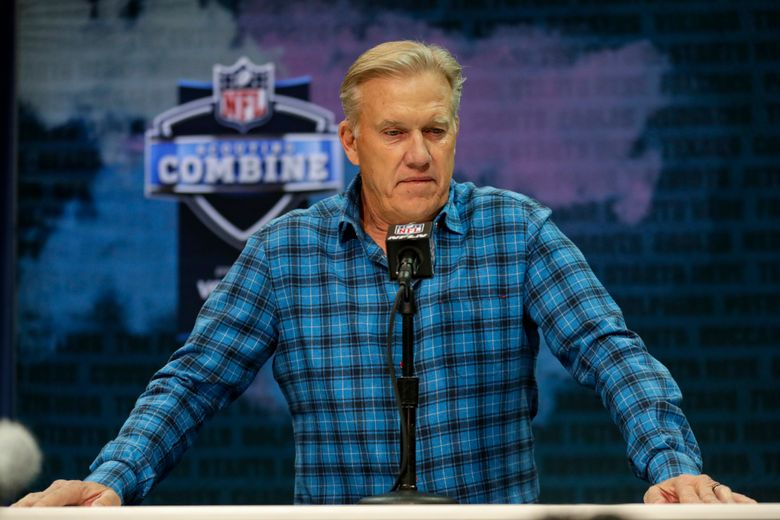 """FILE – In this Feb. 25, 2020 file photo Denver Broncos general manager John Elway speaks during a news conference at the NFL football scouting combine in Indianapolis. NFL teams are having to rely more heavily on game film of college prospects as they prepare for the draft at a time when the COVID-19 pandemic has halted business as usual. On Tuesday, March 31, 2020 Elway said in a conference call, """"We'll just have to conclude the best we can from what we can see on the tape."""" (AP Photo/Michael Conroy)"""