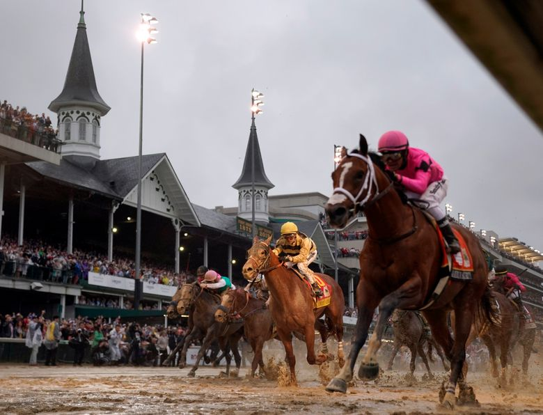 FILE – In this May 4, 2019, file photo, Luis Saez rides Maximum Security, right, across the finish line first against Flavien Prat on Country House during the 145th running of the Kentucky Derby horse race at Churchill Downs in Louisville, Ky. Citing unidentified sources close to the race, the Courier-Journal of Louisville said Churchill Downs will postpone the Derby from May 2, 2020, to Sept. 5, making it the first time in 75 years that the race won't be run on the first Saturday in May. (AP Photo/Matt Slocum, File)