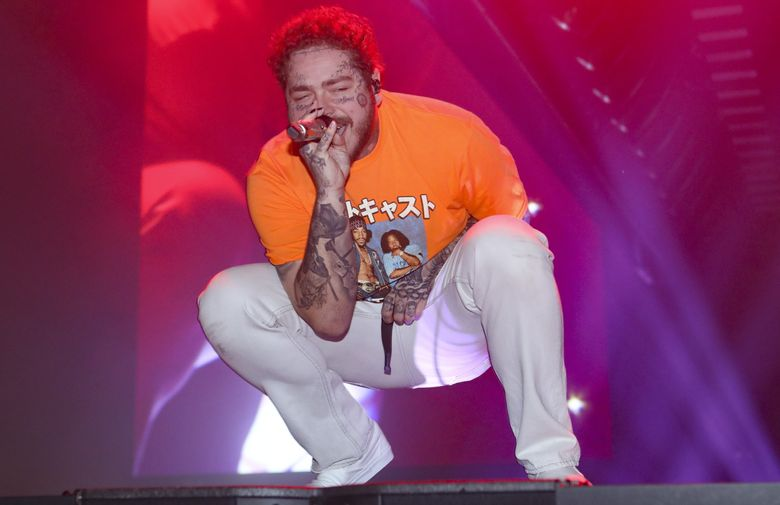 Pop star Post Malone will livestream a Nirvana tribute set for COVID-19 relief on Friday. (Photo by Robb Cohen/Invision/AP)