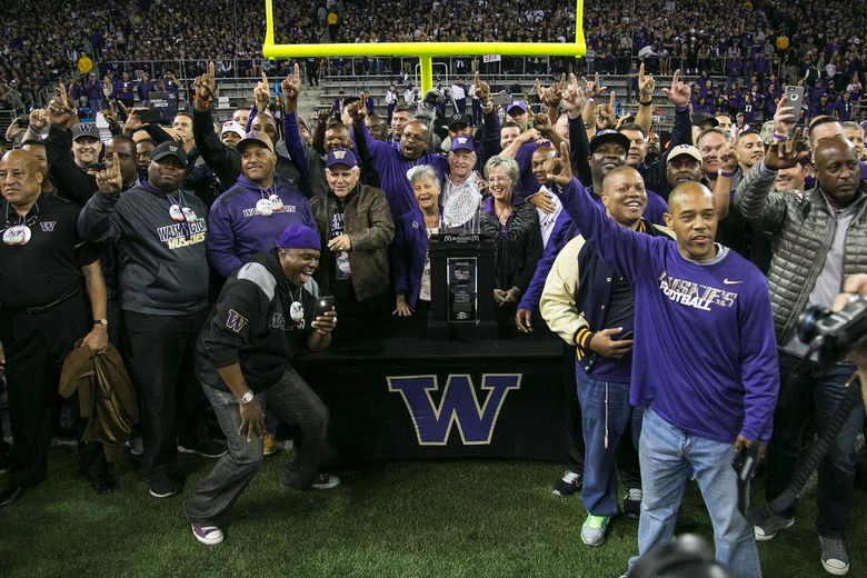 Members of the 1991 National Championship team assemble on the field during a UW game on September 30, 2016, at Husky Stadium in Seattle.  (Johnny Andrews / The Seattle Times)