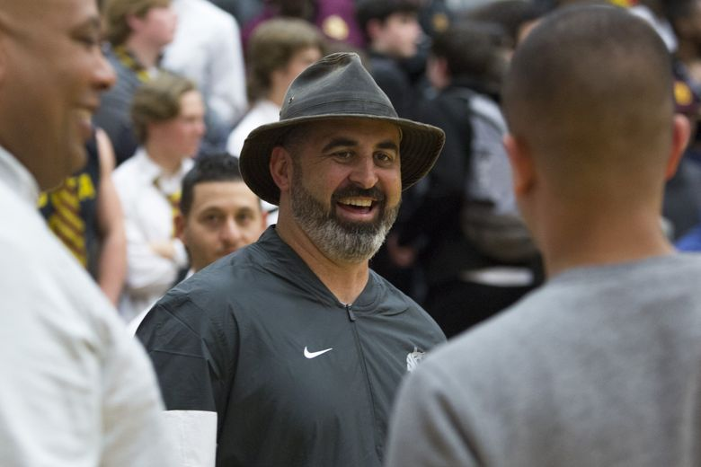 New Washington State football coach Nick Rolovich, pictured before a high-school basketball game at Eastside Catholic, brings a run-and-shoot offense to Pullman. (Jason Redmond / The Seattle Times)