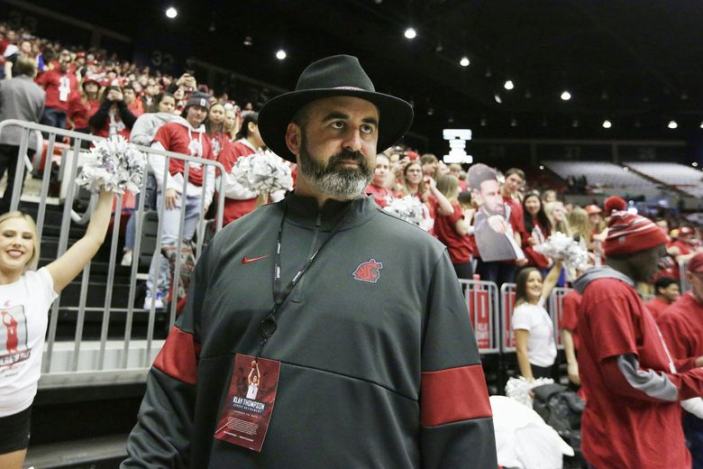 Washington State football head coach Nick Rolovich walks along the court before an NCAA college basketball game between Washington State and Oregon State in Pullman, Wash., Saturday, Jan. 18, 2020. (AP Photo/Young Kwak) OTK (Young Kwak / AP)