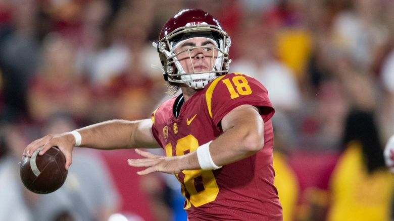 FILE – This Sept. 31, 2019 photo shows Southern California quarterback JT Daniels in an NCAA football game against Fresno State in Los Angeles. Daniels has entered the transfer portal. He announced his plan Thursday, April 16, 2020. Coach Clay Helton says the door is still open for Daniels to stay at USC, where Kedon Slovis took advantage of Daniels' knee injury to become the Trojans' starting quarterback last season. (AP Photo/Kyusung Gong)