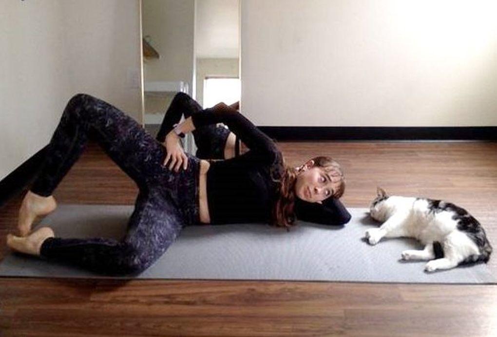 Pacific Northwest Ballet corps de ballet member Abby Jayne DeAngelo works out at home with her cat, Milkshake. (Abby Jayne DeAngelo)