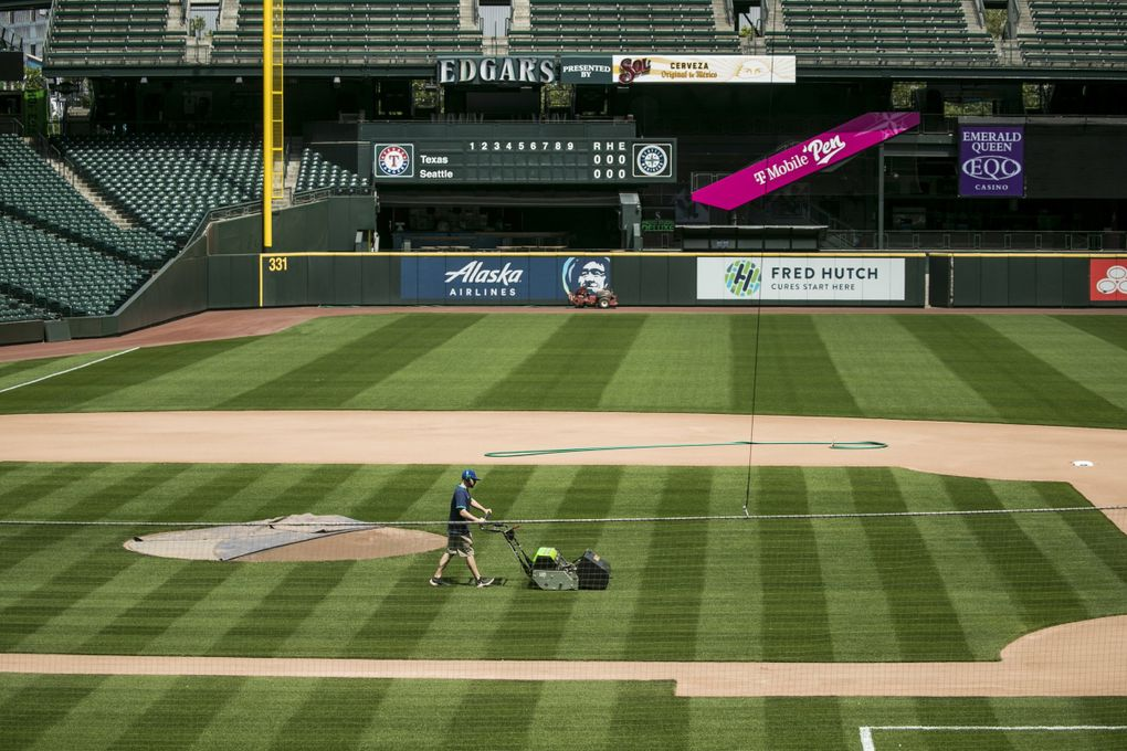 Groundscrew member Marcus Gignac mows the infield at T-Mobile Park on Monday, May 11, 2020. (Amanda Snyder / The Seattle Times)