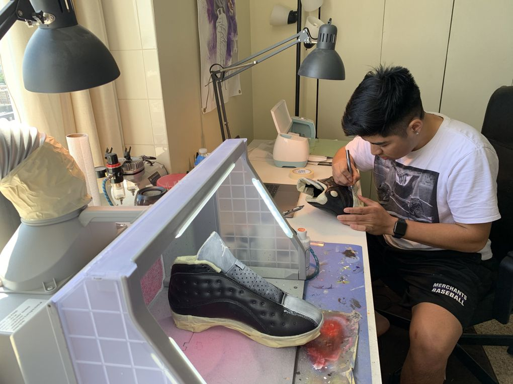 University of Washington freshman Andrew Urrutia works on cleats for Adam Jones, a baseball player in Japan, at his home workshop. (Andrew Urrutia collection)