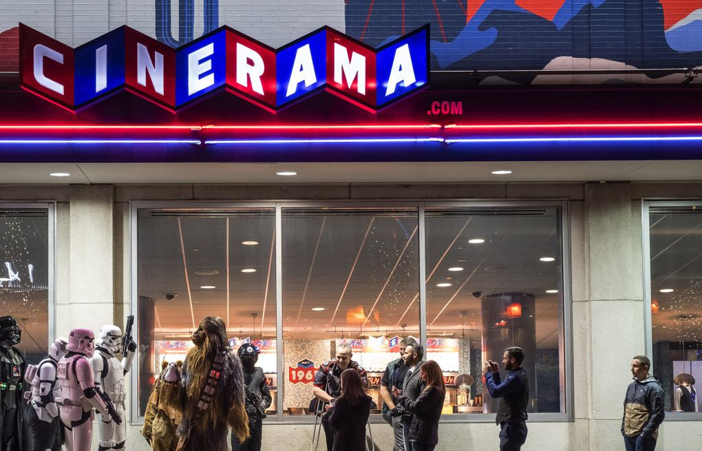 """Fans line up at Cinerama movie theater for the 2017 opening of """"The Last Jedi."""" The popular Seattle cinema has been closed since early 2020. (Dean Rutz / The Seattle Times)"""