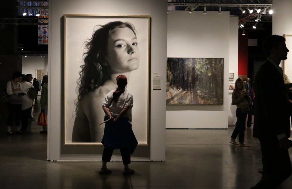 Shown here is a 91-inch charcoal portrait by Clio Newton that was sold by The Forum Gallery at the 2019 Seattle Art Fair, founded by Paul Allen, who was a keen art collector. (Alan Berner / The Seattle Times)