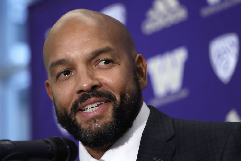 Washington's Jimmy Lake speaks during a news conference Dec. 3 about taking over the head-coaching position. (Elaine Thompson / AP)