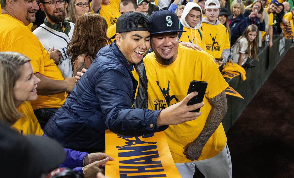 Felix Hernandez take a selfie with Andrew Urrutia in Kings Court following the game on September 26, 2019.(Dean Rutz / The Seattle Times)