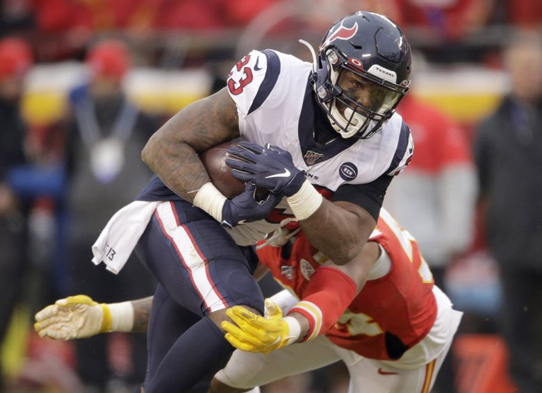 Houston Texans running back Carlos Hyde (23) carries the ball during the first half of an NFL divisional playoff football game against the Kansas City Chiefs, in Kansas City, Mo., Sunday, Jan. 12, 2020.(Charlie Riedel / AP)
