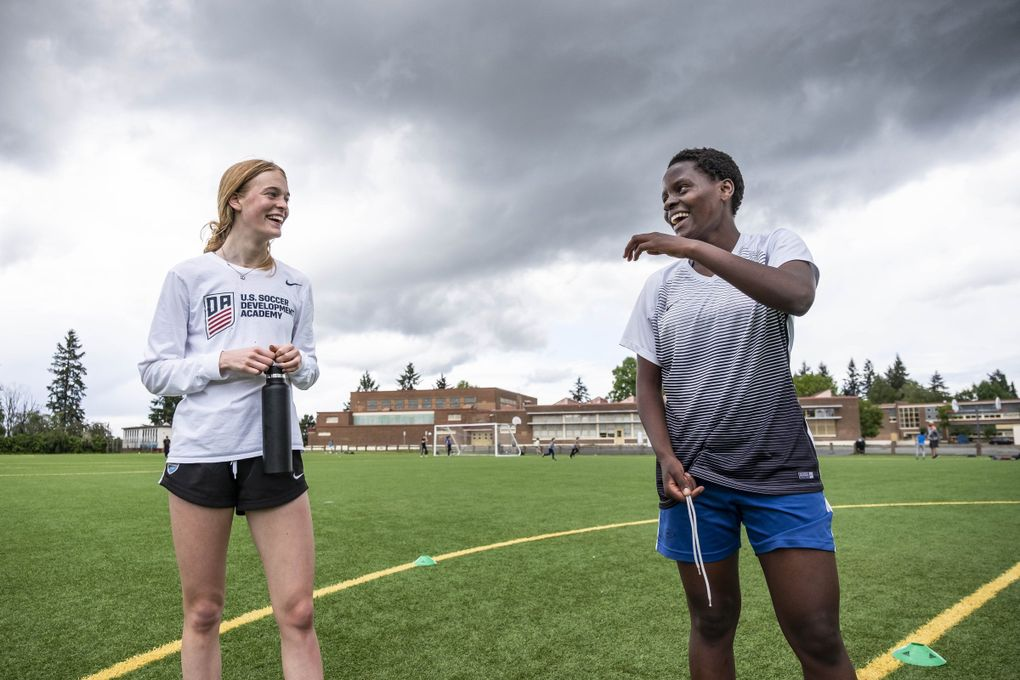 Lughano Nyondo is a 15-year old soccer star in her native Malawi, and she met Ruby Settle in France.  Nyondo was visiting Settle in Seattle on her way to accepting a scholarship in Connecticut.  But when the pandemic hit she was stuck in Seattle.  Settle's family has taken her in and helped her in continuing her training.   Photographed Thursday, May 21, 2020 214032 (Dean Rutz / The Seattle Times)