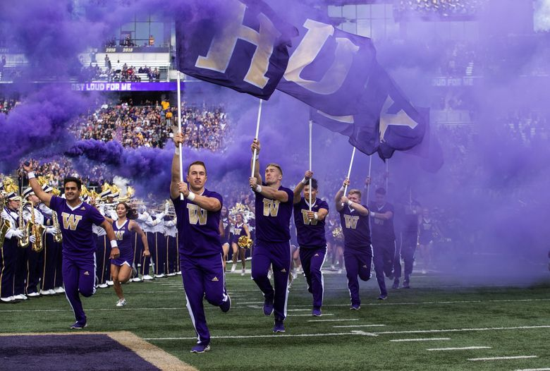 Washington's cheerleaders lead the team out on to the field Saturday against USC.  The University of Southern California played the University of Washington in NCAA Football Saturday September 28, 2019 at Husky Stadium in Seattle, WA. 211622 (Dean Rutz / The Seattle Times)