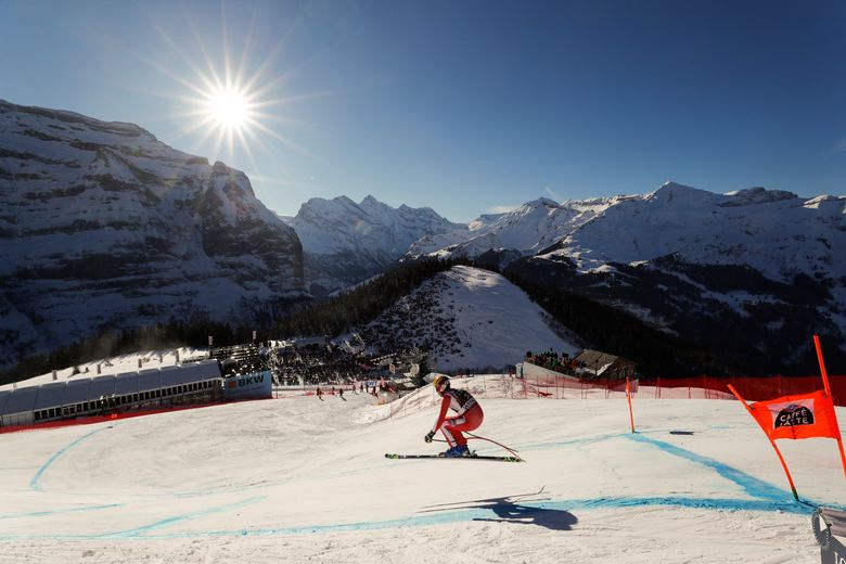 FILE – In this Saturday, Jan. 19, 2019 file photo, Monaco's Arnaud Alessandria speeds down the course during an alpine ski, men's World Cup downhill in Wengen, Switzerland. The signature Alpine skiing race in Switzerland is cancelled this year due to COVID-19.. (Gabriele Facciotti / The Associated Press)