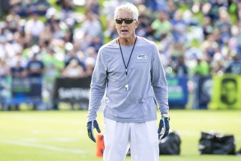 Seahawks coach Pete Carroll watches over training camp at the Virginia Mason Athletic Center in Renton on Aug. 1, 2019. (Bettina Hansen / The Seattle Times)