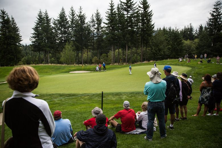 Spectators gather around a hole to watch Fred Couples, Reteif Goosen, and Scott Parel during the Boeing Classic at Snoqualmie Ridge. (Rebekah Welch / The Seattle Times)