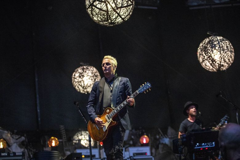 Pearl Jam is slated to join other Seattle music stars for a virtual COVID-19 relief concert on June 24. Shown here is Pearl Jam guitarist Mike McCready during the first of two Home Shows in 2018 at Safeco Field. (Dean Rutz / The Seattle Times)