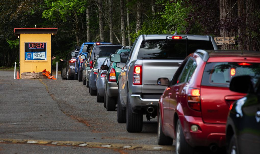 Cars line up at the entrance to the Skyline Drive-In Theater in Shelton earlier this month. Prices right now are $5/vehicle. (Ellen M. Banner / The Seattle Times)