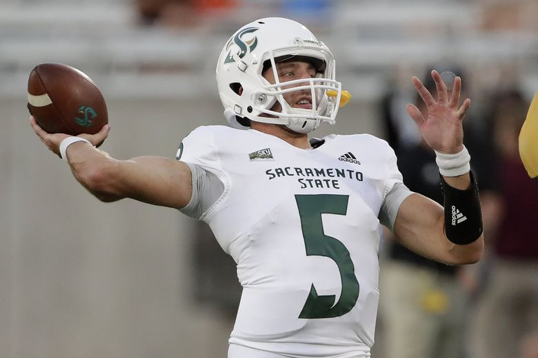 Sacramento State quarterback Kevin Thomson (5) warms up for the team's NCAA college football game against Arizona State, Friday, Sept. 6, 2019, in Tempe, Ariz. (AP Photo/Matt York)