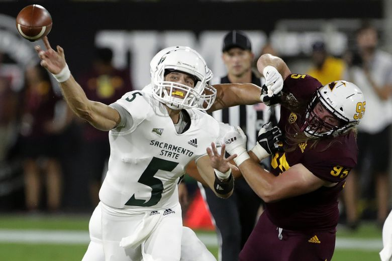Sacramento State quarterback Kevin Thomson (5) throws a pass against Arizona State during the first half of a college football game Friday, Sept. 6, 2019, in Tempe, Ariz.  (Matt York / AP)