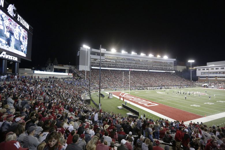 Fans watch the WSU Cougars at Martin Stadium in Pullman, Wash., in 2019. (Young Kwak / Associated Press, file)