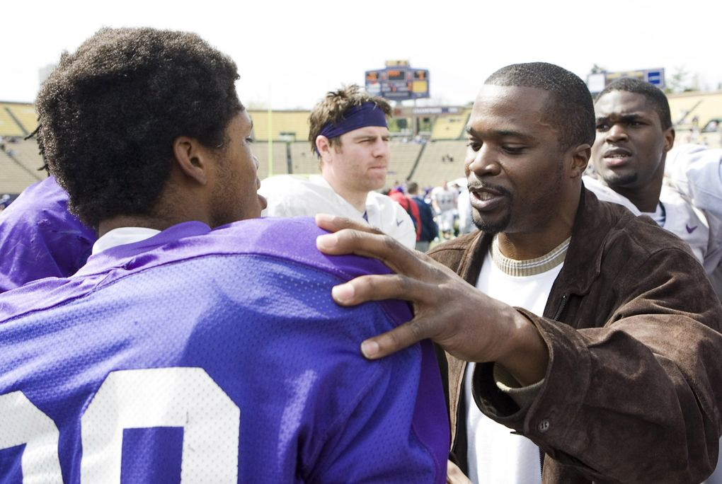 Walter Bailey, right, a member of the University of Washington's 1991 national championship football team, talks with cornerback Marquis Persley after the UW spring football scrimmage at Husky Stadium on April 25, 2009. (Stephen Brashear / AP)