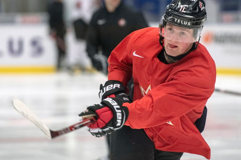 FILE – In this Jan. 1, 2020, file photo, Canada's Alexis Lafreniere shoots during the team's practice at the World Junior Hockey Championships in Ostrava, Czech Republic. The Detroit Red Wings desperately hope to win the NHL draft lottery, giving them the first shot to perhaps select Lafreniere. (Ryan Remiorz/The Canadian Press via AP, File)
