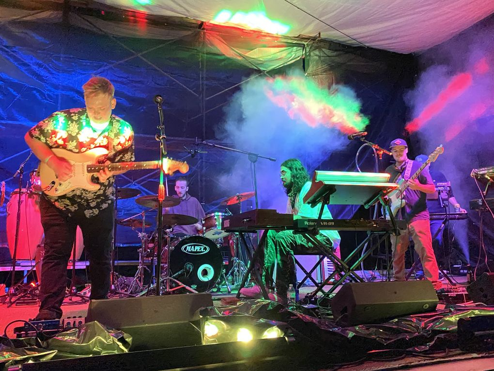 """Seattle jam-funk octet Cytrus headlined the July 11 concert, which broadcast the music through FM radio as fans listened from their cars. """"It's something new for everybody involved,"""" said guitarist Jared Squires, left. (Michael Rietmulder / The Seattle Times)"""