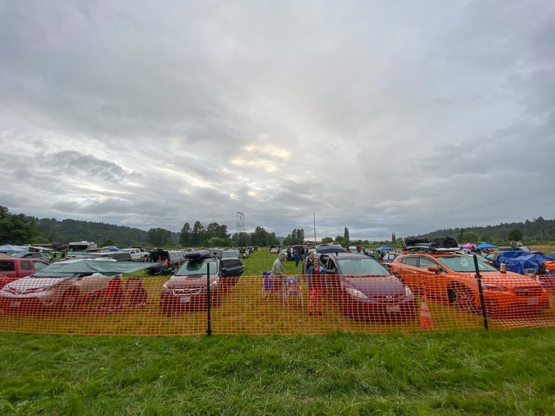 Roughly 130 carloads of music fans attended one of Washington's first drive-in concerts July 11 on a Carnation farm. But such concerts will no longer be allowed under a new rule imposed by Gov. Jay Inslee on Thursday. (Michael Rietmulder / The Seattle Times)