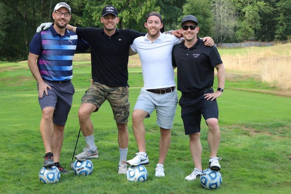 """Participants pose at the """"soccer hole"""" – where the object is to kick a soccer ball into a small goal to take a stroke off your final score – at the DP Open.  (Courtesy of / Adam Lang)"""