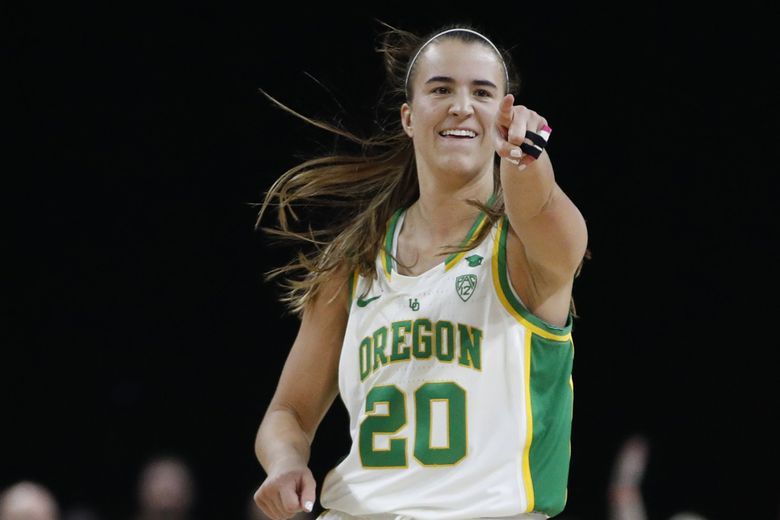 In this March 8, 2020, file photo, Oregon's Sabrina Ionescu (20) reacts after her team scored against Stanford during the second half of an NCAA college basketball game in the final of the Pac-12 women's tournament in Las Vegas. (John Locher / The Associated Press)