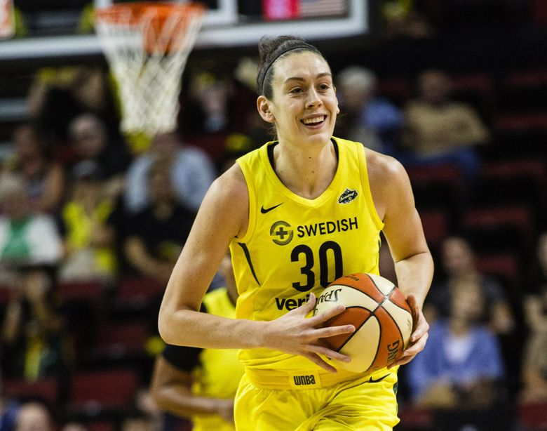 Breanna Stewart smiles as she looks to pass down the court after blocking a Wings shot in the game at Key Arena, August 19, 2018. Storm beat the Wings 84-68. (Rebekah Welch / The Seattle Times)