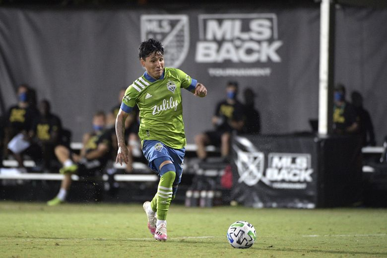 Seattle Sounders forward Raul Ruidiaz controls a ball during the second half of an MLS match against the Vancouver Whitecaps on July 19.    (Phelan M. Ebenhack / The Associated Press)
