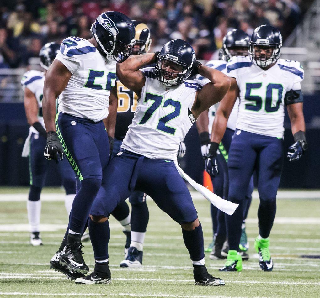 Seahawks defensive lineman Michael Bennett celebrates a sack on Rams quarterback Nick Foles on Sept. 13, 2015.(Bettina Hansen / The Seattle Times)