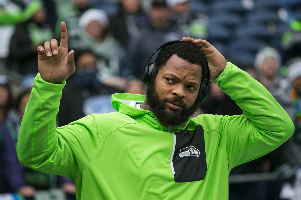 Seattle Seahawks defensive end Michael Bennett acknowledges the crowd Dec. 24, 2016, at CenturyLink Field. (Johnny Andrews / The Seattle Times)