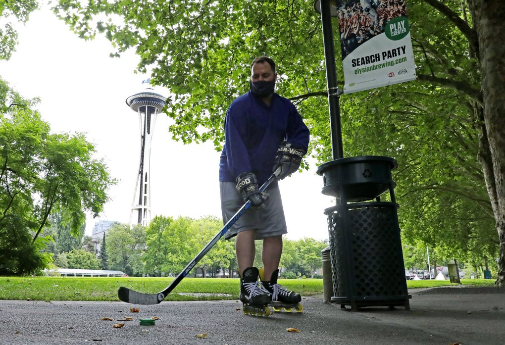 Local hockey fan Mark Siano was so excited for the announcment of Seattle NHL's team, he showed up at Seattle Center with his stick on Thursday. Siano said when growing up in the area, he never thought this day would come. (Ken Lambert / The Seattle Times)
