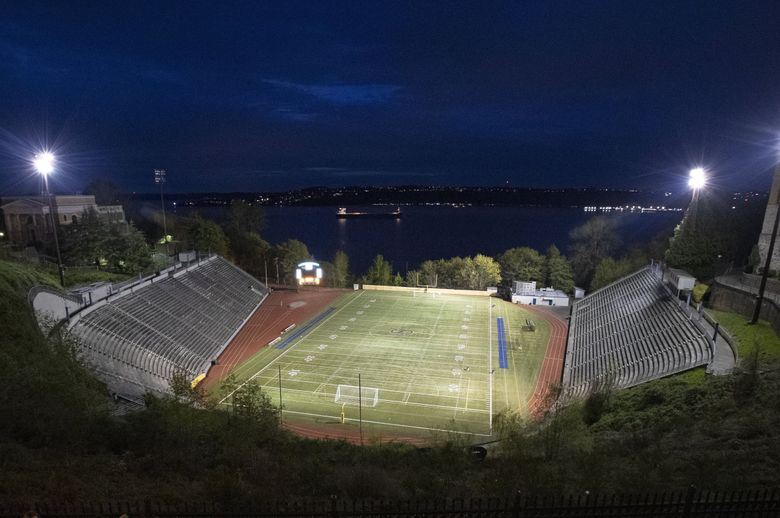 """Lights at the Stadium Bowl are turned on in tribute to the high school class of 2020, Friday, April 17, 2020, at Stadium High School in Tacoma, Wash. Lights were on Friday for 20 minutes at stadiums and other school facilities across the state of Washington as part of an ongoing """"Be the Light"""" tribute the high school class of 2020 who have had their graduation school years disrupted by the outbreak of the coronavirus.  (Ted S. Warren / AP)"""