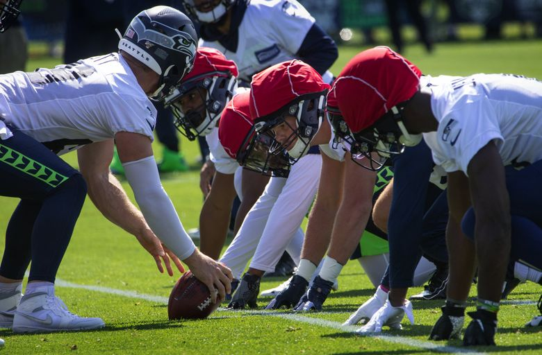 Seahawks' Jackson Harris, TE, #47, (center) goes through drills at training camp at the VMAC in Renton in 2019. (Ellen M. Banner / The Seattle Times)