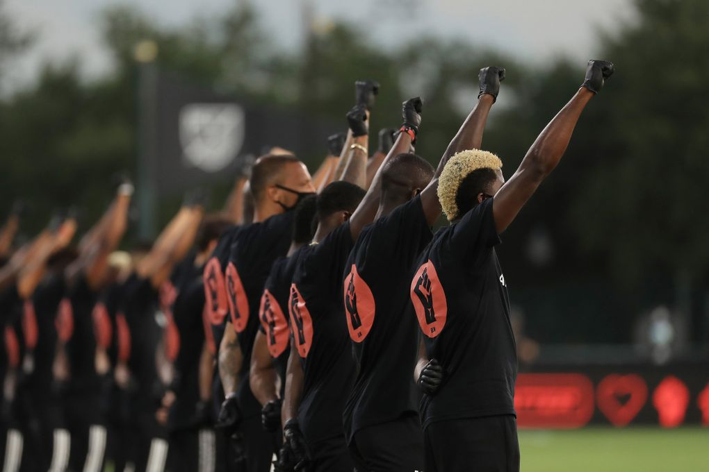 MLS players participate in a Black Lives Matter pregame ceremony before a match between Orlando City and Inter Miami during the MLS is Back tournament at Disney's ESPN Wide World of Sports in Orlando, Florida, on Wednesday, July 8, 2020.  (Mike Ehrmann / TNS)