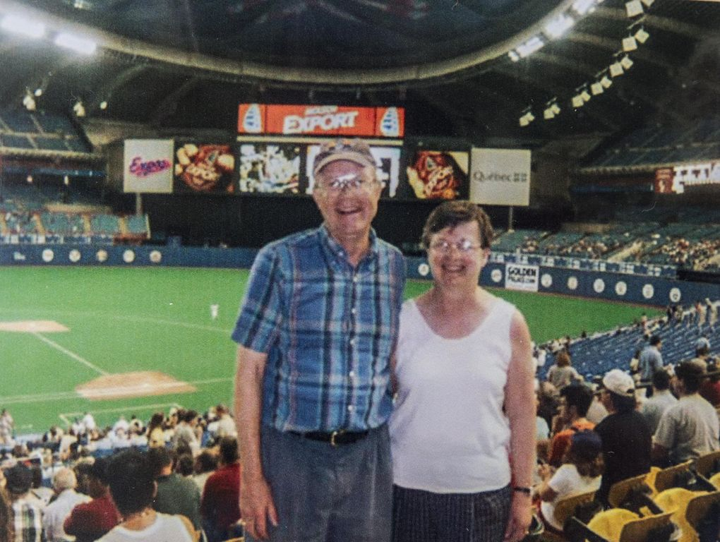 In a photo out of their major league scrapbook, Jim and Andrea Siscel pose in the Montreal Expos' Olympic Stadium in 2003. (Steve Ringman / The Seattle Times)