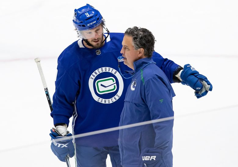 Vancouver Canucks' J.T. Miller talks to head coach Travis Green during the team's training camp in 2020 in Vancouver B.C. (Darryl Dyck / The Canadian Press via AP)