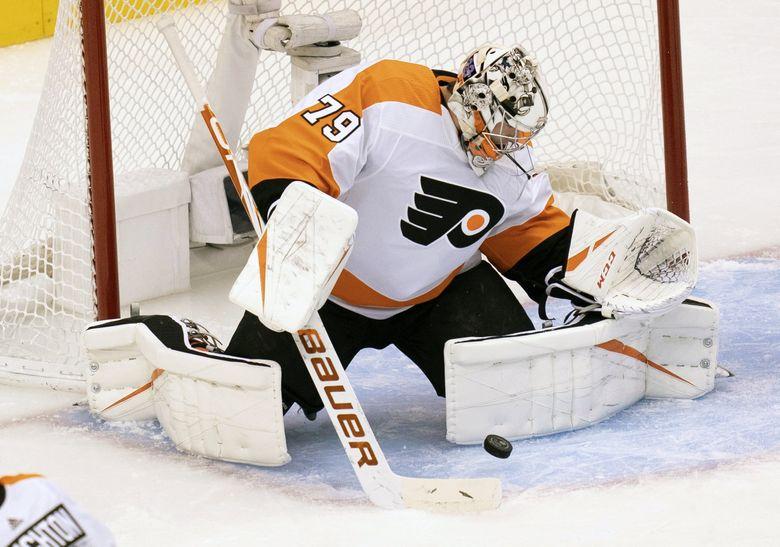 Philadelphia Flyers goaltender Carter Hart (79) makes a save against the Boston Bruins during first-period NHL hockey playoff action in Toronto, Sunday, Aug. 2, 2020. (Frank Gunn/The Canadian Press via AP) (Frank Gunn / AP)