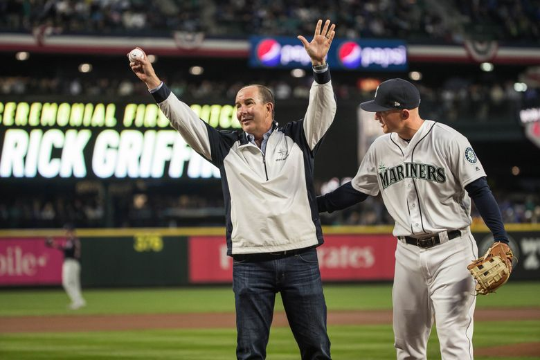 Former trainer Rick Griffin, with Kyle Seager, had the ceremonial first pitch on March 29, 2018 at Safeco Field. (Dean Rutz / The Seattle Times, file)