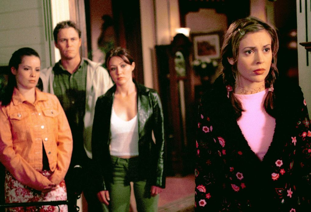 """""""Charmed"""" stars pictured, from left to right: Holly Marie Combs as Piper Halliwell, Brian Krause as Leo Wyatt, Shannen Doherty as Prue Halliwell and Alyssa Milano as Phoebe Halliwell. (Byron Cohen / The WB)"""