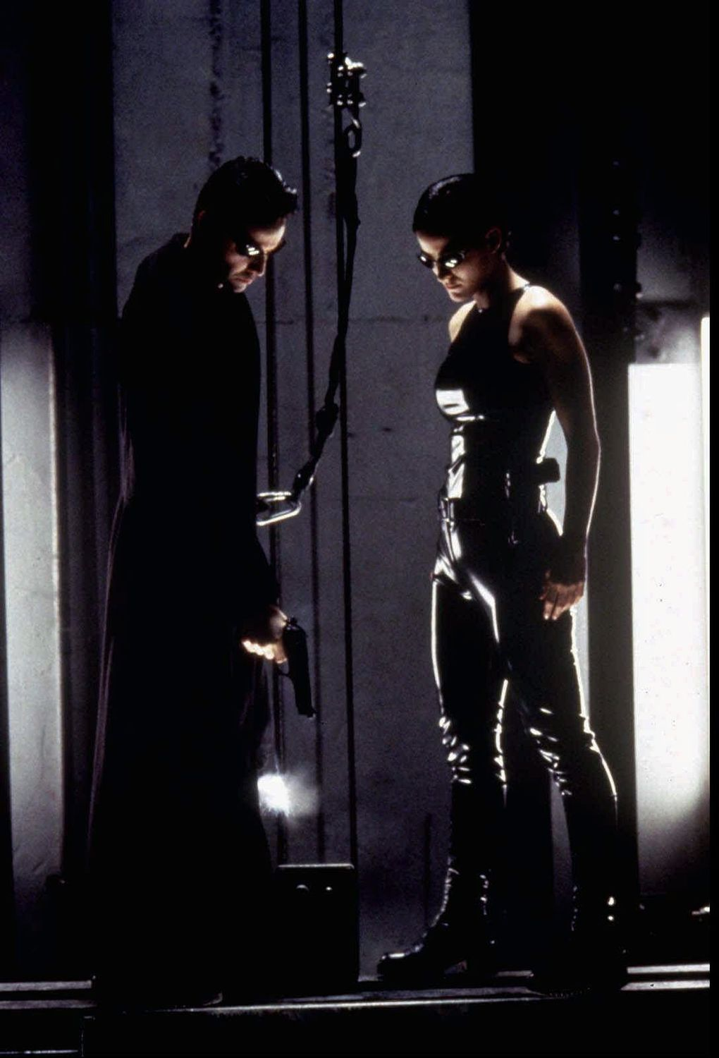 """""""There is no spoon."""" Keanu Reeves and Carrie-Anne Moss in The Matrix. (Jasin Boland / GPN)"""