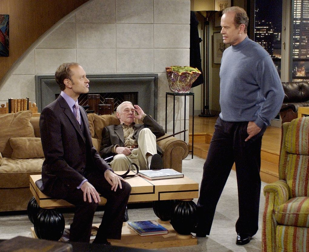 """""""Frasier"""" star Kelsey Grammer, right, as Dr. Frasier Crane, talks with co-stars David Hyde Pierce as his brother Niles, left, and John Mahoney during filming of the final episode of the """"Cheers"""" spinoff, which wrapped in 2004 after 11 seasons. (Reed Saxon / The Associated Press, FIle)"""